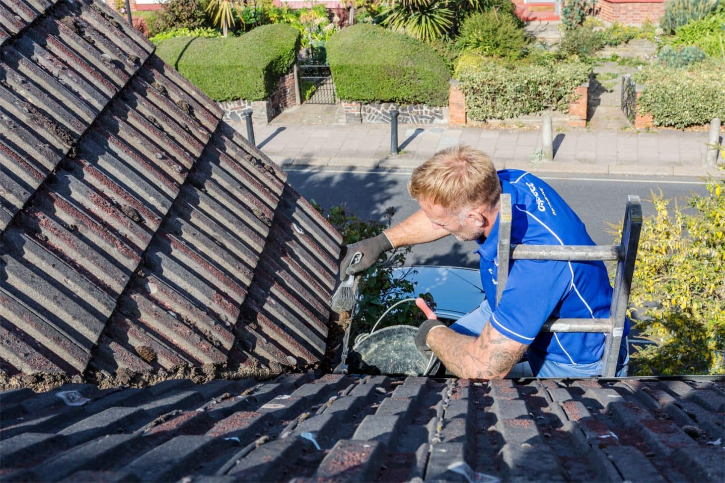 Cleaning gutters of leaf litter, moss and other debris